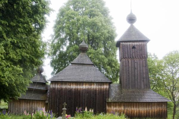 Side view of the wooden church, with the three domes clearly visible | Protection of Mother of God church | Slovakia
