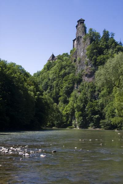 Picture of Rock needle rising out of the river with Orava castle on top