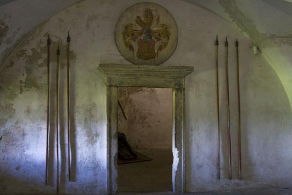 Spears and a coat of arms on a door in one of the rooms of Orava castle | Orava Castle | Slovakia