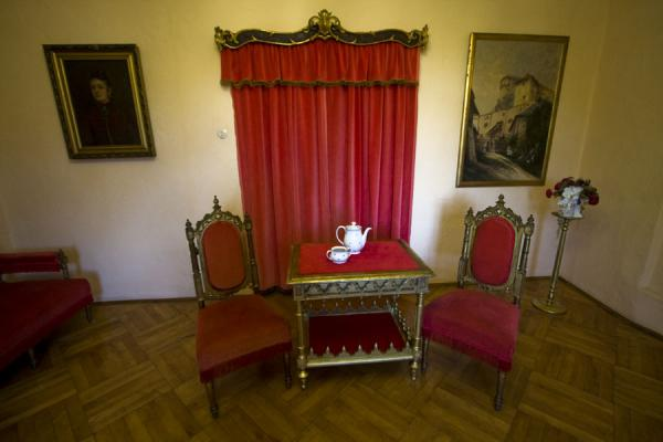 Red curtain and posh chairs in one of the rooms of the castle | Orava Castle | Slovakia