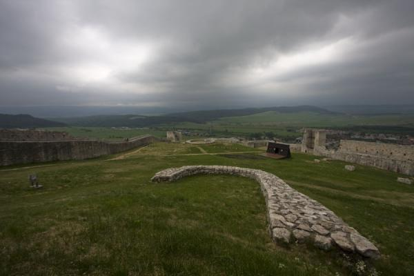 Dark skies over the defensive walls and inner terrain of Spiš Castle | Spiš Castle | Slovakia