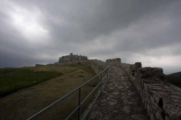 Picture of Spiš Castle (Slovakia): The defensive wall of Spiš Castle under a dark sky