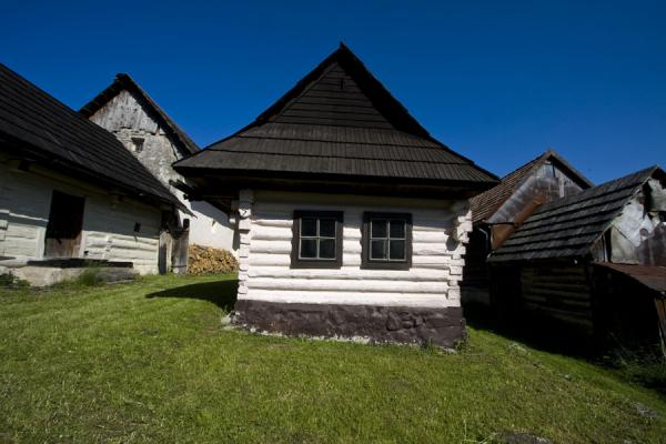 Picture of Vlkolínec (Slovakia): Wooden cabin with painted logs are typical for Vlkolínec