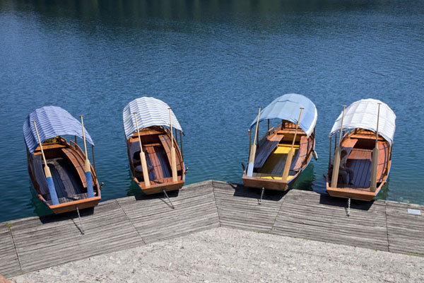 Boats waiting for passengers docked at Bled Island | Lake Bled | Slovenia