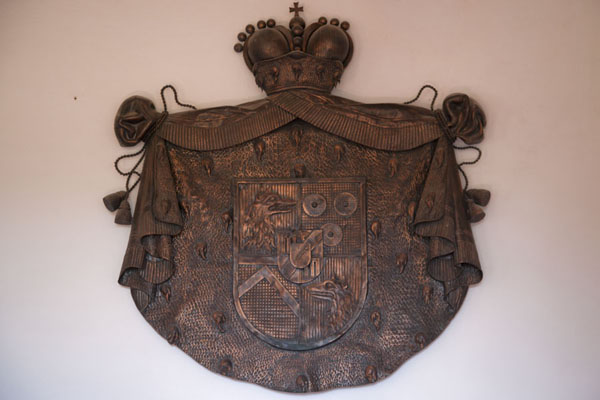 Picture of Predjama Castle (Slovenia): Coat of arms of the Windischgrätz family on display on a wall of Predjama Castle