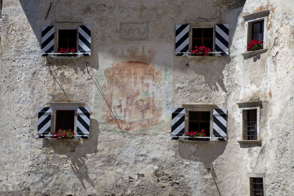 Close-up of the wall of Predjama Castle with painting | Predjama Castle | Slovenia