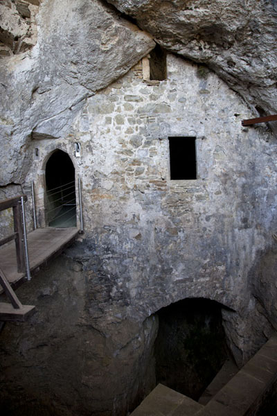 The entrance to the grotto castle in Predjama Castle | Predjama Castle | Slovenia