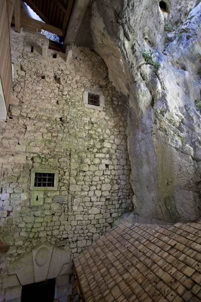 Wall built right into the cave at Predjama Castle | Predjama Castle | Slovenia