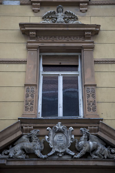Picture of Window with sculptures on a building in the old town of Ptuj