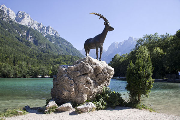 Statue of Zlatorog, mythical chamois with golden horns, at the shore of Jasna Lake | Vršič mountain pass | Slovenia
