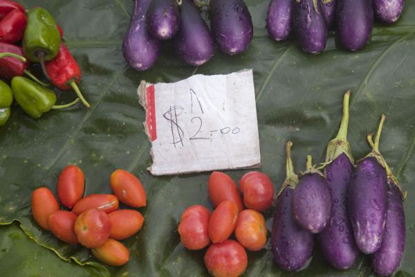 Close-up of leaf with peppers, tomatoes, and eggplant | Gizo market | Solomon Islands