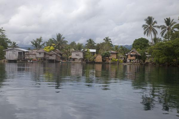 Picture of One of the villages of Langa Langa reflected in the tranquil waters of the lagoonTalakali - Solomon Islands
