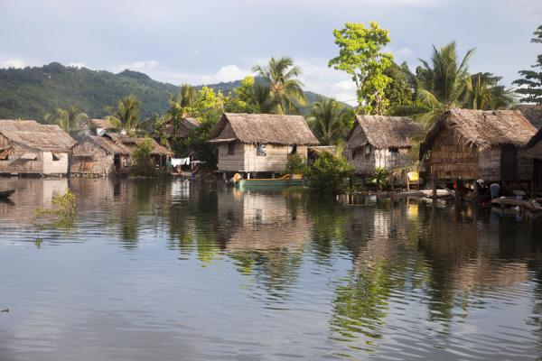 Reflection of traditional houses and trees in the brook of Lilisiana | Lilisiana | Solomon Islands