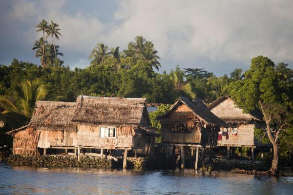 Sunrise over the houses of Lilisiana | Lilisiana | Solomon Islands