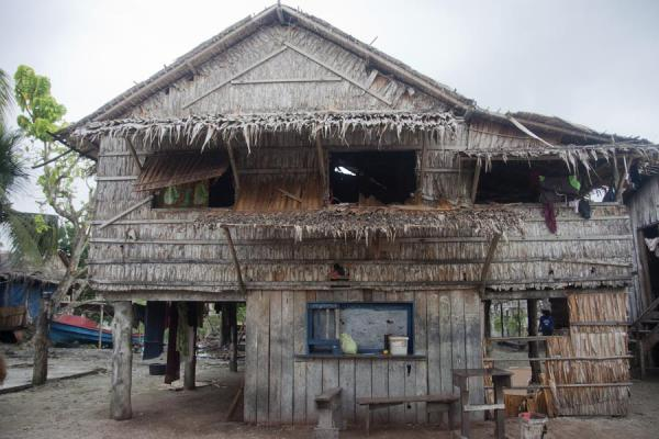 House and shop window on the main street of Lilisiana | Lilisiana | Solomon Islands