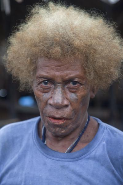 Picture of Solomon Island people (Solomon Islands): Woman with tattooed face posing for the photo in Lilisian, on Malaita island