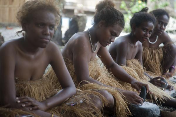 Picture of Solomon Island people (Solomon Islands): Women dressed up in traditional clothes making shell-money