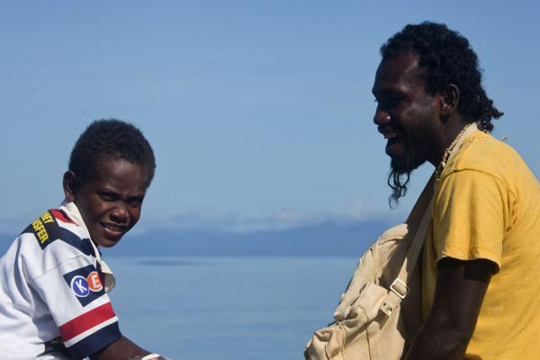 Young boy with uncle on a boat at Kolombangara island | Solomon Island people | Solomon Islands