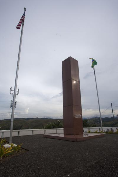 Picture of The pillar flanked by the American and Solomon flagHoniara - Solomon Islands