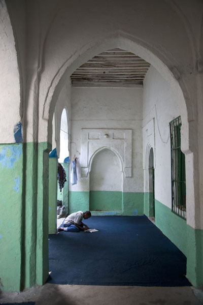 Lone man praying at the portal of the mosque | Fakr ad-Din mosque | Somalia