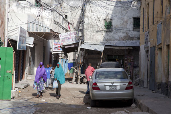 Picture of Women walking an alley in the old city of Mogadishu