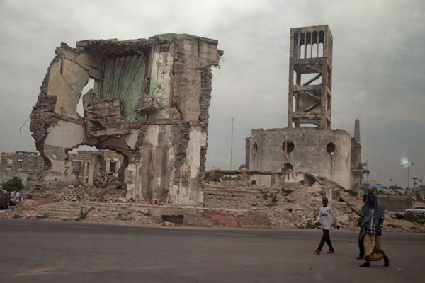 Picture of People walking past ruins in the city of Mogadishu