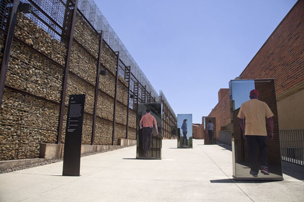 On the ramp leading up to the roof of the Apartheid Museum, real people are depicted | Apartheid Museum | South Africa