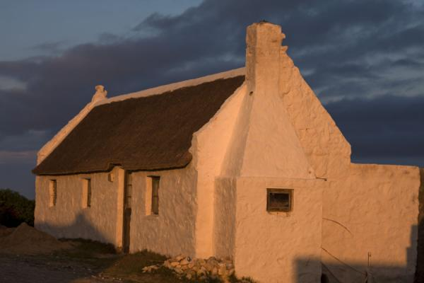 Late afternoon sunlight on one of the typical houses of Arniston | Arniston | South Africa