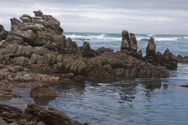 Rocks in the surf of the Indian and Atlantic Ocean at Cape Agulhas | Cape Agulhas | South Africa