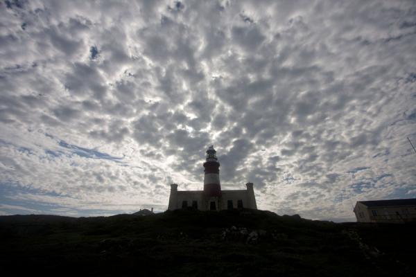 Picture of Cape Agulhas (South Africa): The contours of the lighthouse at Cape Agulhas under a cloudy sky