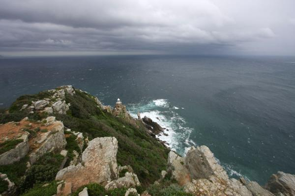 Foto di Dark clouds and rain showers over the ocean near Cape PointCape Point - Africa del Sud