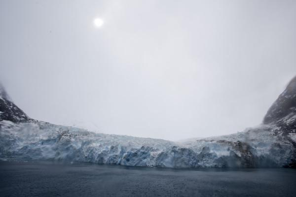 Vague sun shining over the Risting Glacier at the end of Drygalski Fjord | Drygalski Fjord | South Georgia and South Sandwich Islands