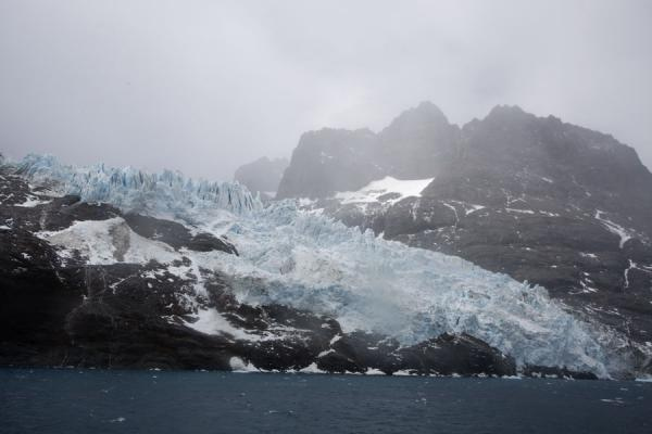 Picture of Glacier coming down the rocks and ending up in Drygalski Fjord - South Georgia and South Sandwich Islands - Antarctica