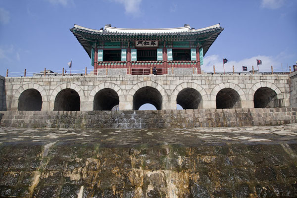 Picture of Looking up Hwahongnum gate with Suwoncheon stream running though it - South Korea - Asia