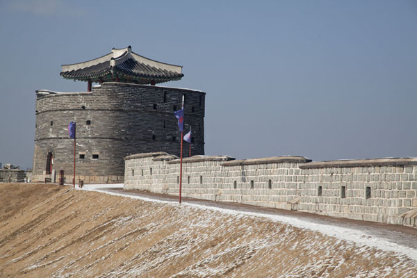 Picture of Hwaseong fortress (South Korea): View of the wall and circular Dongbuk Gongsimdon observation tower