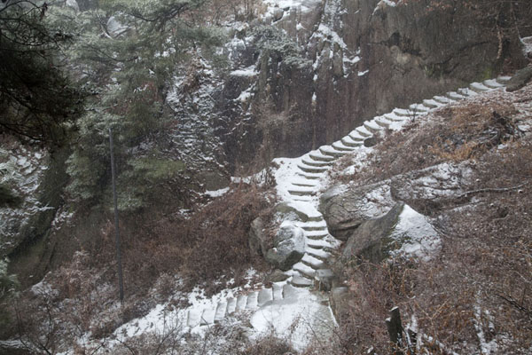 Picture of Inwangsan (South Korea): Snow-covered stairs in a rocky landscape on Inwangsan