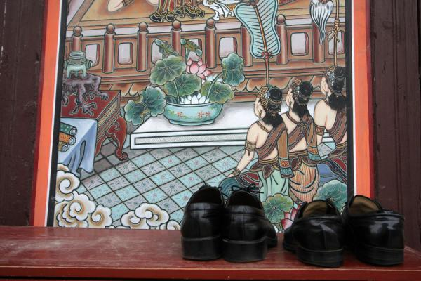 Picture of Jogyesa Temple (South Korea): Still outside the Great Hero Hall: shoes and wooden panel