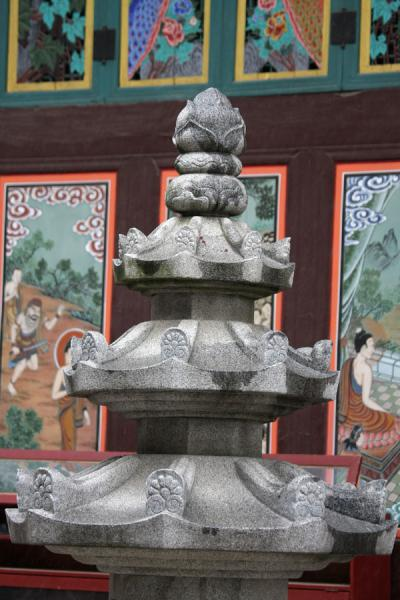 Picture of Jogyesa Temple (South Korea): Small stone pagoda with decorated wooden panels outside Jogyesa temple