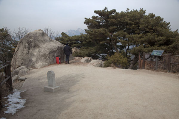 The summit of Mount Bugaksan with one of the many black-dressed military staff | Mount Bugaksan City Wall | South Korea