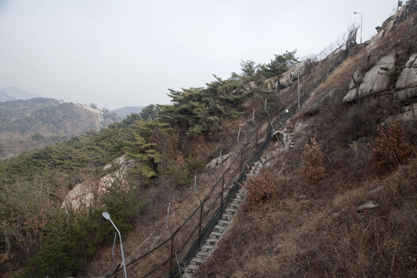 Fence with lanterns below Mount Bugaksan | Mount Bugaksan City Wall | South Korea