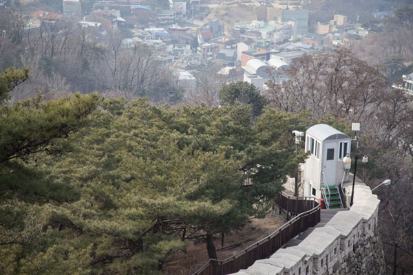 Picture of Looking down the city wall with a watch tower near Changiumun Gate - South Korea - Asia