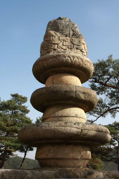 Picture of Namsan (South Korea): Three-wheeled pedestal with Buddha statue at Yongjangsa