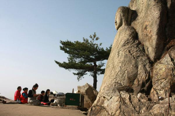 Picture of Namsan (South Korea): Praying in front of seated Seokgayeorae