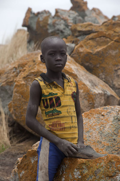 Young kid posing on a rock at the top of Jebel Kujul | Jebel Kujul | South Sudan