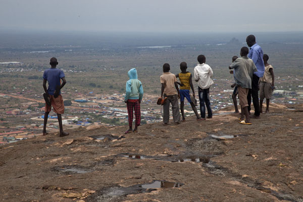 Kids and young man looking out over Juba from the top of Jebel Kujul | Jebel Kujul | South Sudan