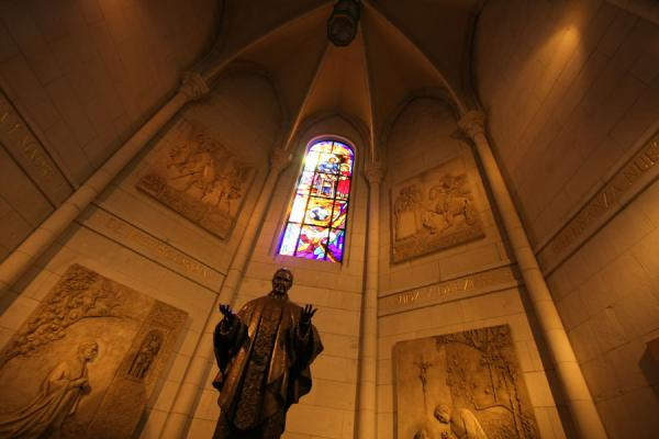 Picture of Almudena Cathedral (Spain): Statue under stained glass window in a chapel in Almudena Cathedral