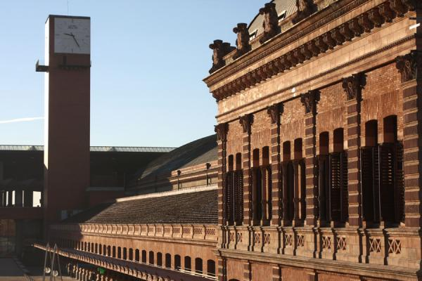 Old and new: renovated old Atocha station with the modern part behind | Atocha Station | Spain