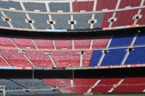 One corner of Camp Nou stadium with colourful benches | Camp Nou stadium | Spain