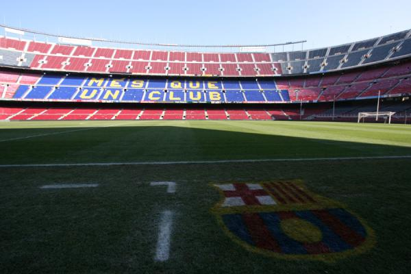 Picture of FC Barcelona emblem in the grass of the pitch near the dugout