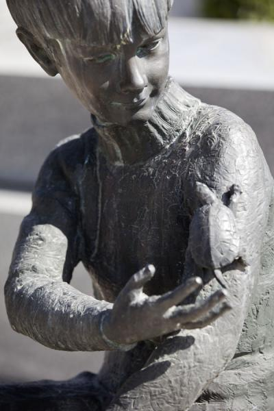 Statue of boy with turtle on one of the many graves of Almudena cemetery | Almudena begraafplaats | Spanje